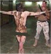 یک عکس از شکنجه زندانیان ابوغریب