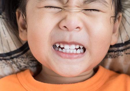 علت دندان قروچه کودک در خواب چیست,علت دندان قروچه در کودکان