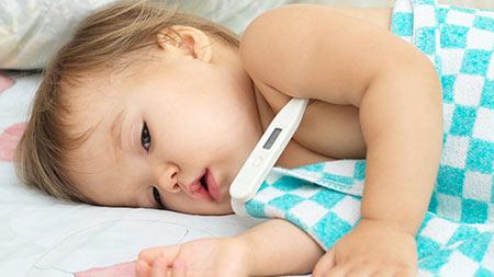 خروسک,درمان خروسک در کودکان,تب کردن کودک
