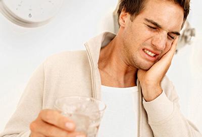 دلایل ایجاد مشکلات دندان ,درد دندان پر شده